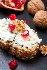 Blue cheese with pomegranate and nuts
