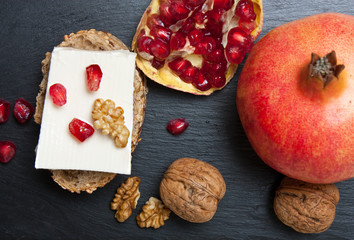 Fresh cheese with pomegranate and nuts