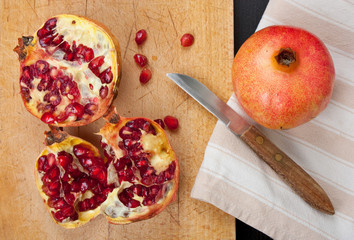 Pomegranate on cutting board