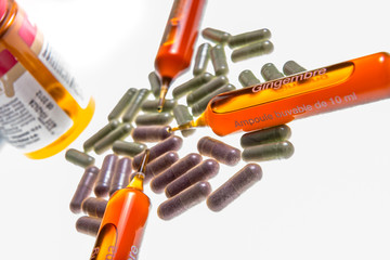 Close up of vitamin ampuls and natural pills