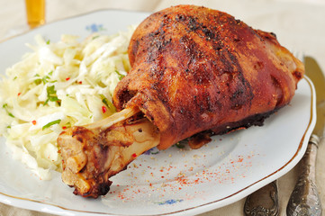 Roasted pork shank with fresh cabbage salad