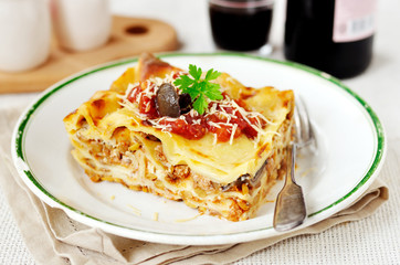 Rustic style lasagna with pork, mushrooms and lentils