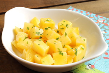 Steamed potato cubes with parsley and olive oil