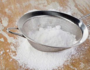 Powdered sugar in a metal sieve