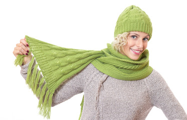 Smiling female playing with her scarf, isolated on white