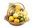 Fresh fruit in a wicker basket on the white