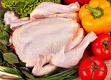 Fresh raw chicken and vegetables prepared for cooking
