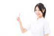young asian nurse showing on white background