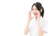 young asian nurse yelling on white background