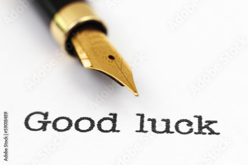 Fountain pen on good luck text