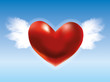 Red heart with wings in the blue sky
