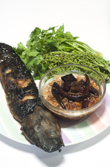 Grilled catfish and tamarind sauce and neem.