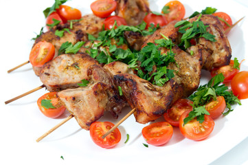 Barbecue on skewers, garnished with cherry