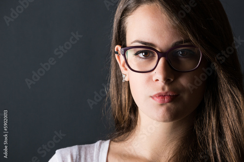 Pensive Young Woman on Dark Background