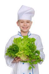 Laughing cook with fresh herbs