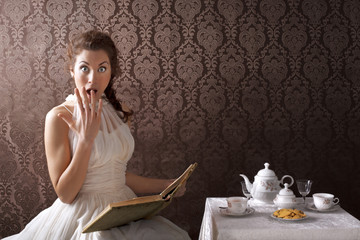 beauty surprise woman read a book in the tea time