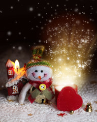 Christmas background with snowman magical glow of the gift