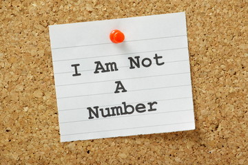I am not a number concept on a cork notice board