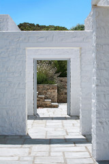 Whitewashed geometric passageway to house