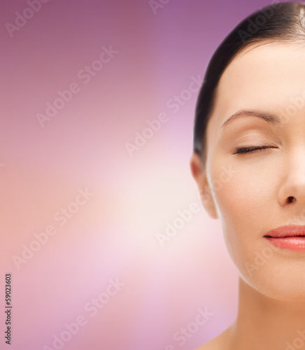 relaxed young woman with closed eyes