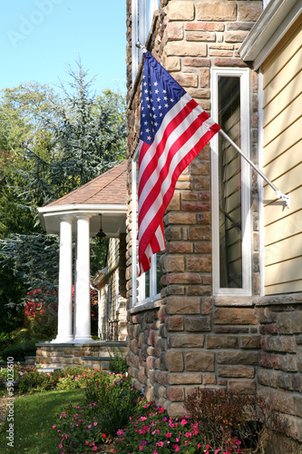 Exterior of house with American flag