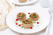 Stuffed mushrooms with herbs and pomegranate seeds, top view