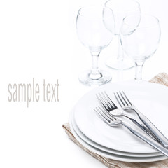 tableware for dinner - plates, forks and glasses, isolated