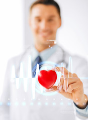 male doctor with heart and cardiogram