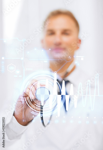 male doctor with stethoscope and cardiogram
