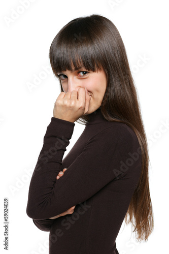 Playful shy woman hiding face smiling timid