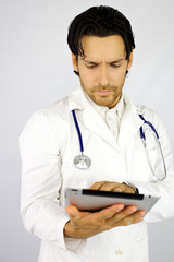 Doctor at work with tablet