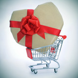 heart-shaped gift in a shopping cart