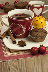 still life with tea mugs and  chocolate muffins with decoration
