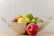 Apple basket with the white wall background