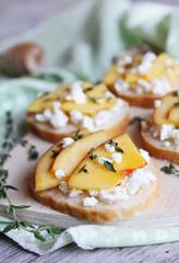 Bruschetta with nectarines, feta cheese, thyme and honey