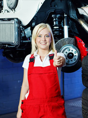 Girl is proud of her apprenticeship in a garage
