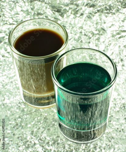 Shot Glass with Green and Coffee Cocktails