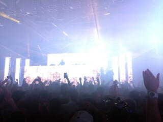 crowd of young party people at dj concert