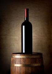 Bottle of wine on a barrel