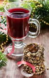 Chocolate filled cookies and juice with festive decorations
