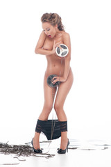 Attractive nude woman covered up with an audio retro bobbins