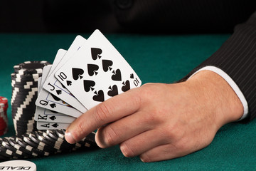 Man hand holding poker cards