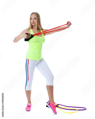 Pretty girl exercising with gymnastic simulator