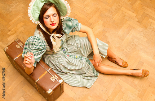girl with suitcase in retro style
