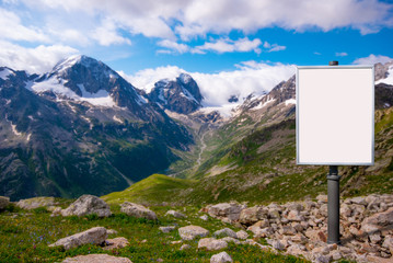 billboard for advertising mounted on a meadow among the mountain
