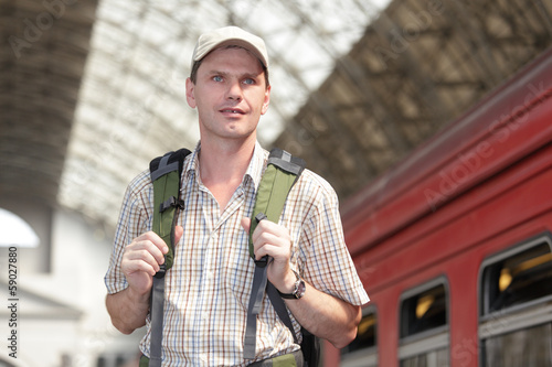 Tourist on a train station