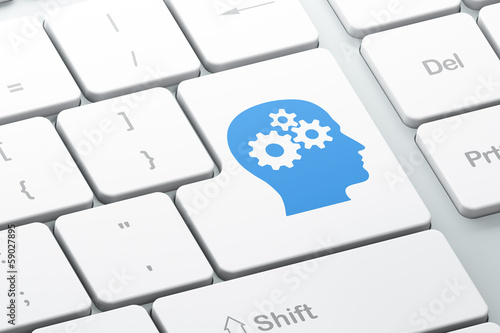 Education concept: Head With Gears on keyboard background