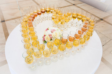 Festive glasses arranged in a heart shaped form