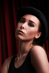 attractive female in bowler hat