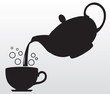 Black silhouette of teapot and cup